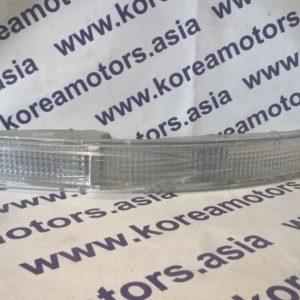 Поворотник передний SsangYong Korando New (левый, белый) 8330106500