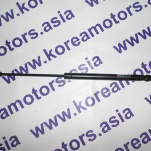 Амортизатор задней двери Kia Sorento (левый, 2003 -) 871703E010